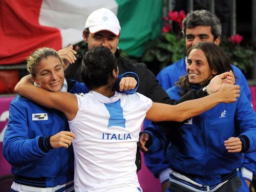 schiavone celebrates with teammates